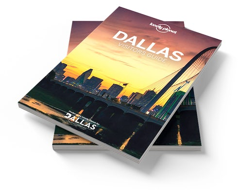 Stack of Visit Dallas Visitor's Guides