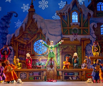 Elf Musical performance with cast on stage.